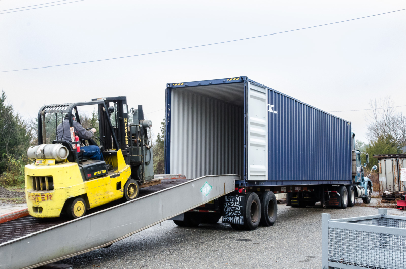 Loading a Container - Cook Tool & Machinery